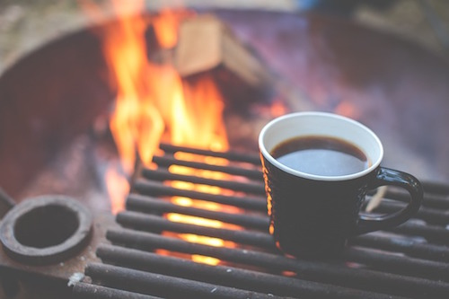 coffee beside a camp fire